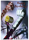 Happy Birthday card with noisemakers on front